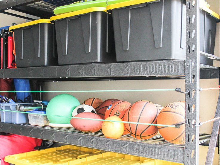 From U0027Lowesu0027, This Is An Easy Way To Make That Same Kind Of Ball Storage.  Wood Dowels And Bungee Cords. This Project Is Actually From The Garage Wall  ...