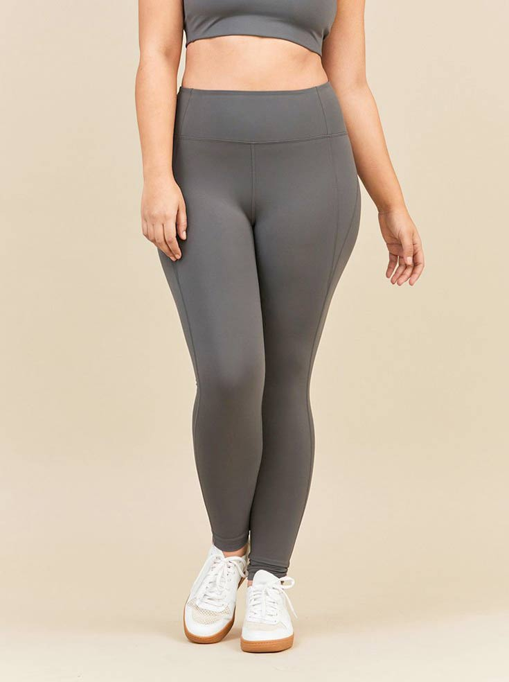 ffc97ef95d ... with a wide range of sizes is the Smoke Compressive High Rise legging  from Girlfriend Collective. This pant has an extra high rise so you don't  have to ...